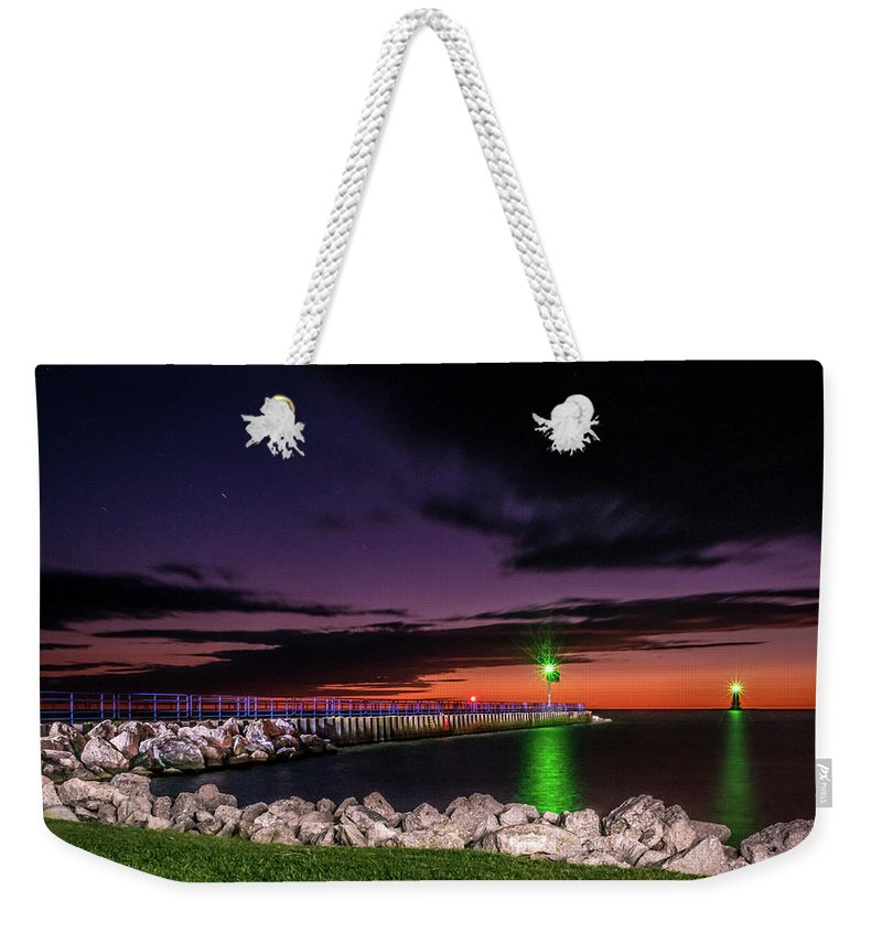 Lake Michigan Weekender Tote Bag featuring the photograph Pier And Lighthouse by Lester Plank