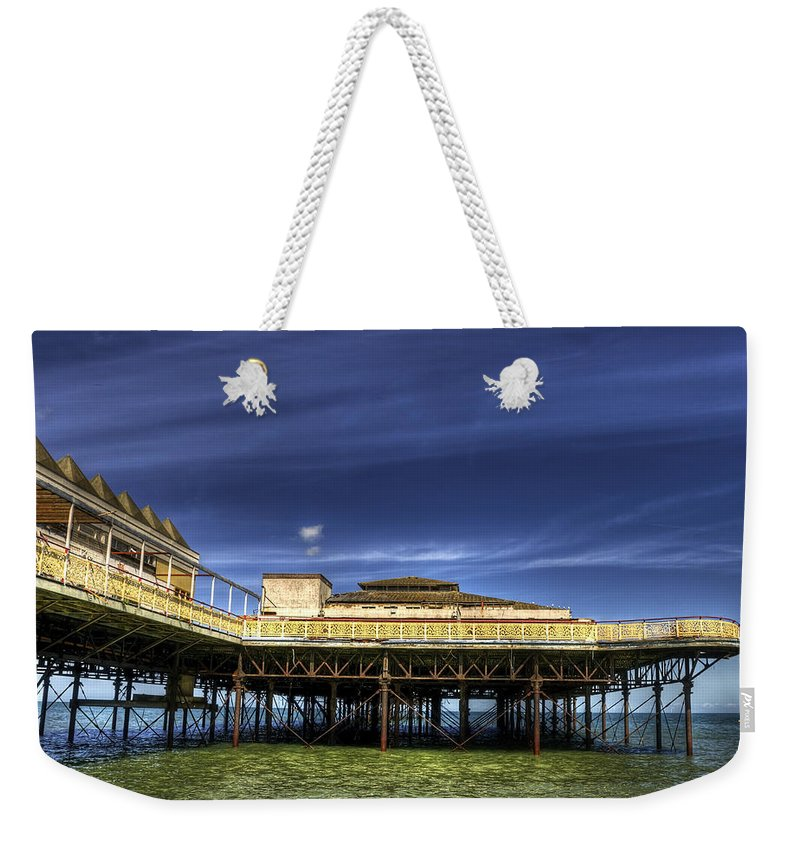 Beach Weekender Tote Bag featuring the photograph Pier Structure by Svetlana Sewell