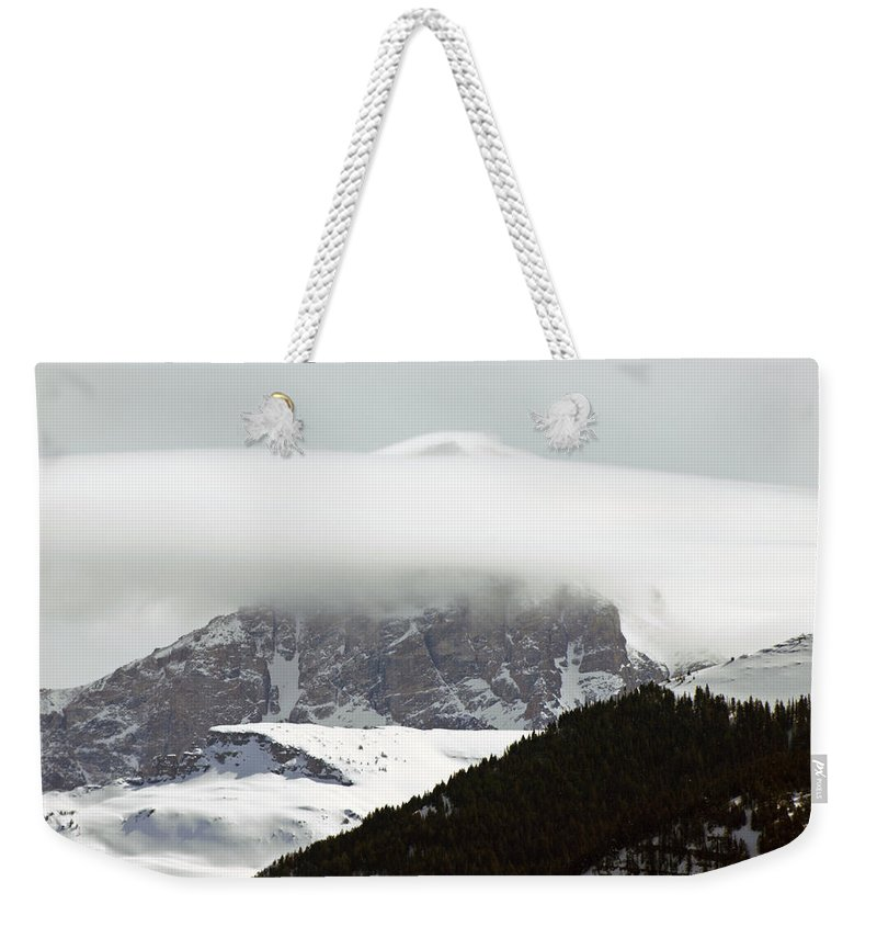 Landscape Weekender Tote Bag featuring the photograph Piercing The Clouds by DeeLon Merritt