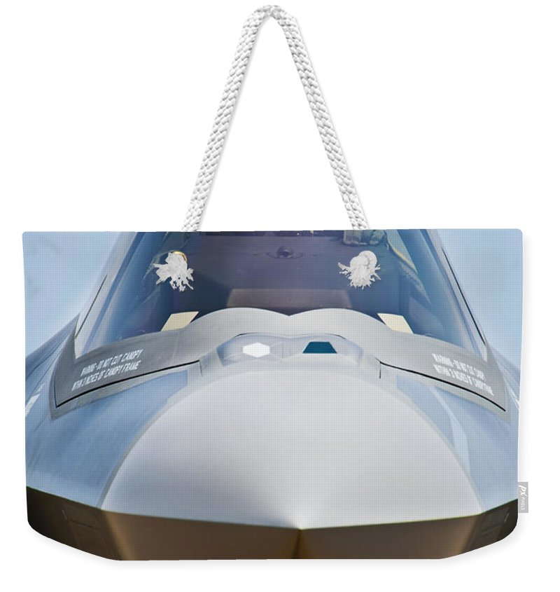 Aerospace Weekender Tote Bag featuring the photograph Pilot In The Cockpit Of A U.s. Air by Stocktrek Images