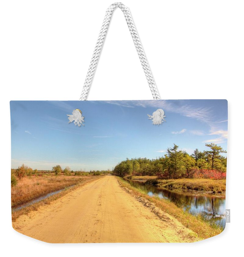 Recent Weekender Tote Bag featuring the photograph Pine Barrens Of New Jersey Cranberry Harvest Bogs by Geraldine Scull
