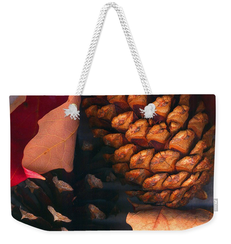 Pine Cones Weekender Tote Bag featuring the photograph Pine Cones And Leaves by Nancy Mueller