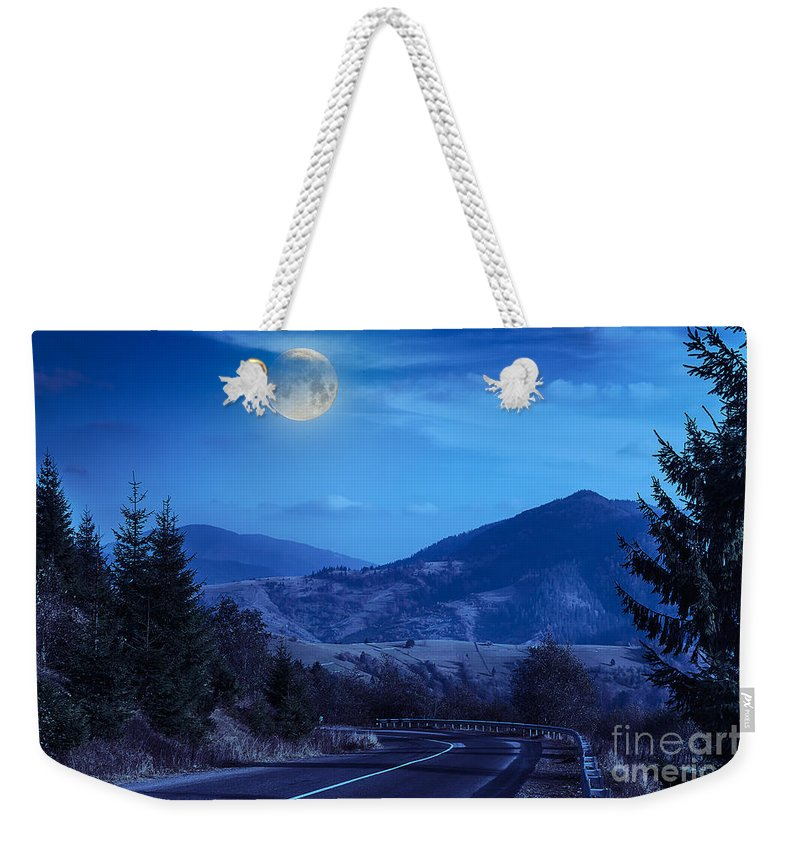 Landscape Weekender Tote Bag featuring the photograph Pine Trees Near Valley In Mountains And Autumn Forest On Hillsid by Michael Pelin