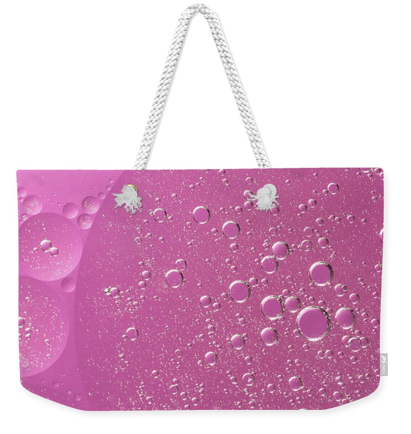 Abstract Weekender Tote Bag featuring the photograph Pink Abstract Of Oil Droplet. by Jaroslav Frank