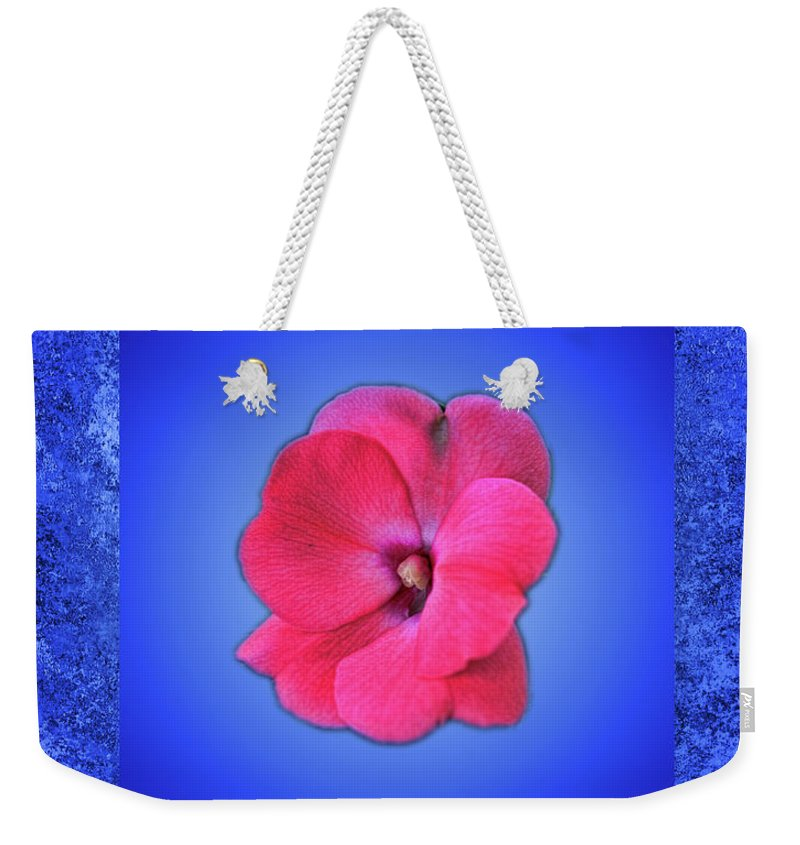 Flower Weekender Tote Bag featuring the photograph Pink And Blue by Bob Welch