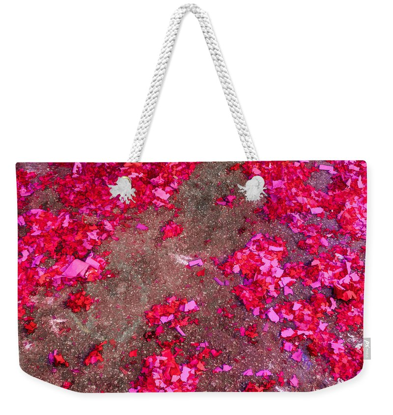 Bonnie Follett Weekender Tote Bag featuring the photograph Pink And Red Firecracker Debris Abstract by Bonnie Follett
