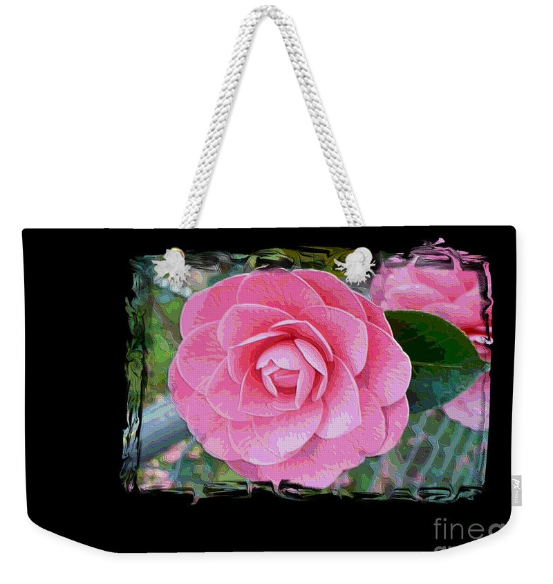 Pink Camelllias Weekender Tote Bag featuring the photograph Pink Camellias With Fence And Framing by Carol Groenen