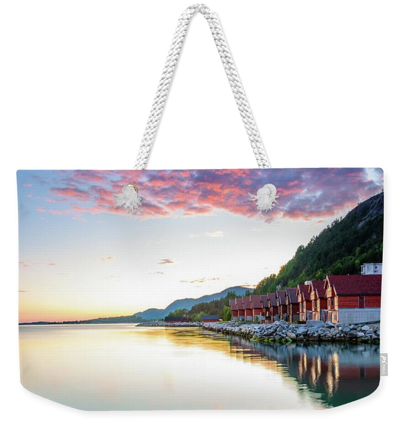 Symmetry Weekender Tote Bag featuring the photograph Pink Sunset Over A Lagoon In Norway by Todor Nikolov