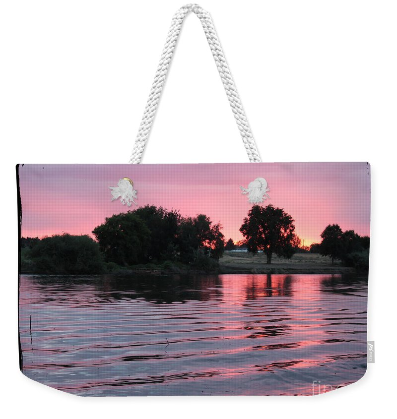Pink Sunset Weekender Tote Bag featuring the photograph Pink Sunset With Soft Waves In Black Framing by Carol Groenen