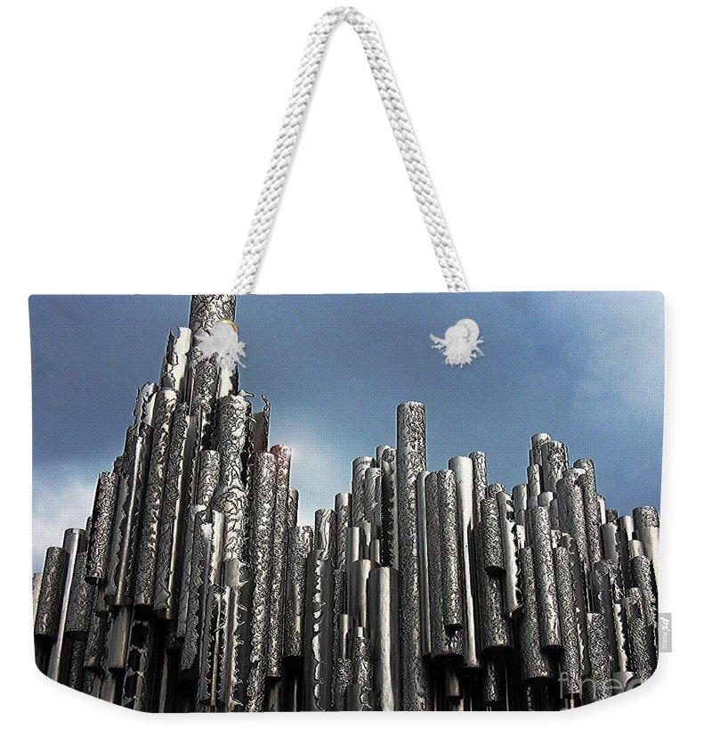 Helsinki Weekender Tote Bag featuring the photograph Pipe Dreams by Steve C Heckman