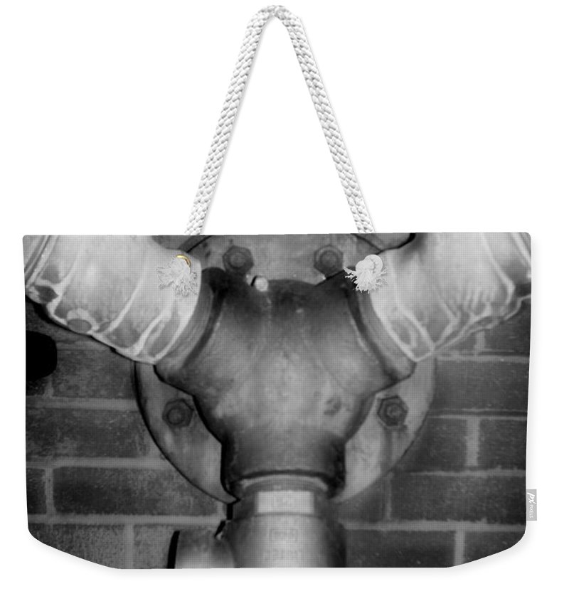Color Photograph Weekender Tote Bag featuring the photograph Pipe by Thomas Valentine