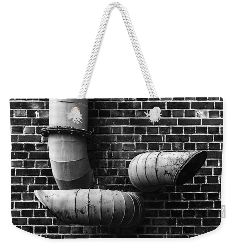 Abstract Weekender Tote Bag featuring the photograph Pipes by Joseph Yvon Cote