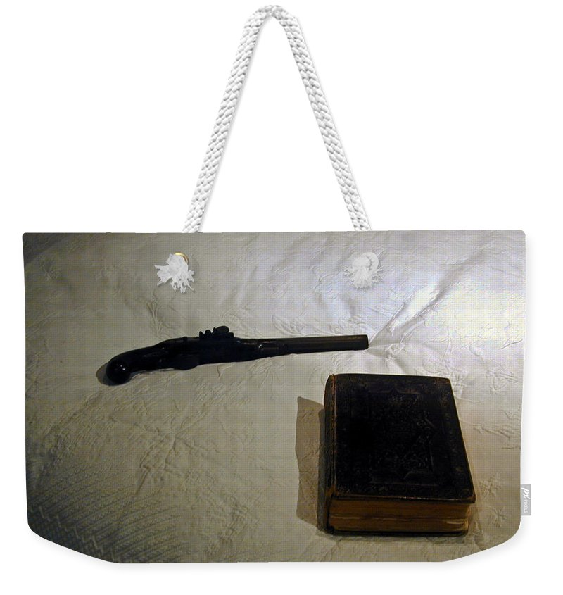 Pistol Weekender Tote Bag featuring the photograph Pistol and Bible by Douglas Barnett