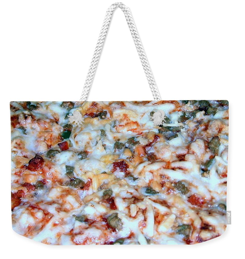 Frozen Pizza Weekender Tote Bag featuring the photograph Pizza by Amy Hosp