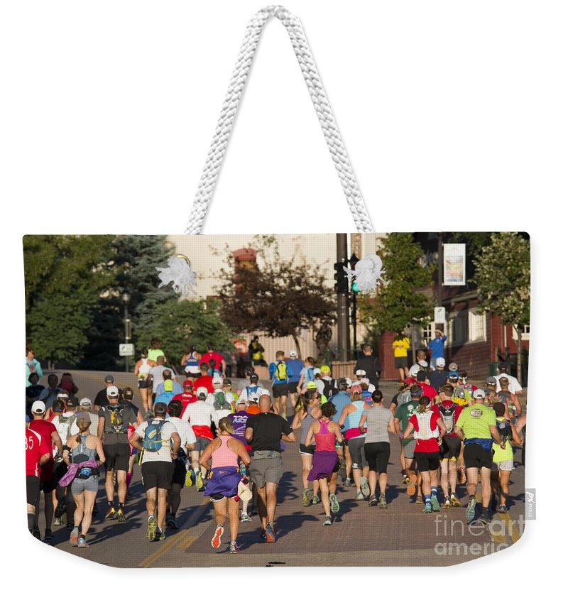 Pikes Peak Weekender Tote Bag featuring the photograph Pikes Peak Marathon And Ascent by Steve Krull