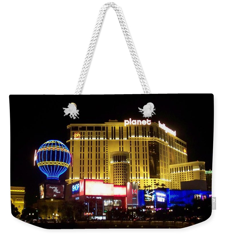 Vegas Weekender Tote Bag featuring the photograph Planet Hollywood By Night by Anita Burgermeister