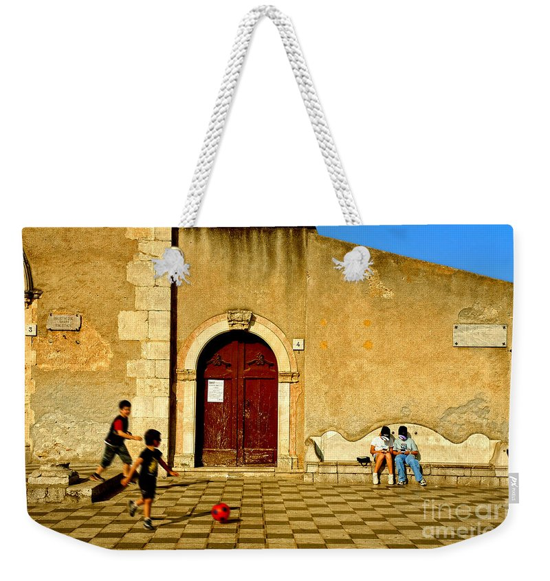 Antique Weekender Tote Bag featuring the photograph Playing In Taormina by Silvia Ganora