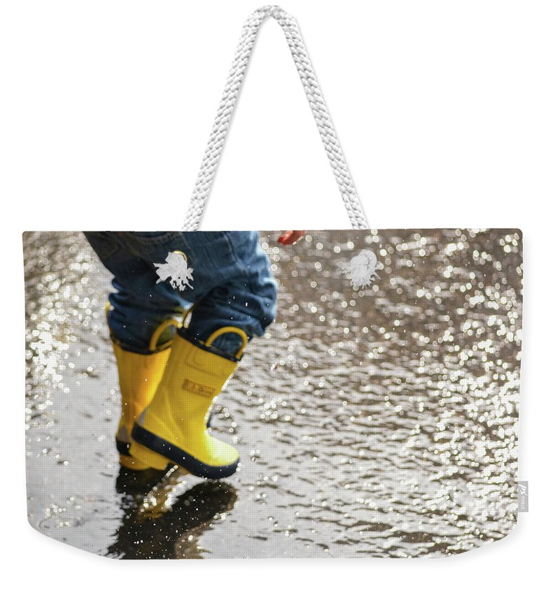 Boots Weekender Tote Bag featuring the photograph Playing In The Puddles by Jesse MacDonald
