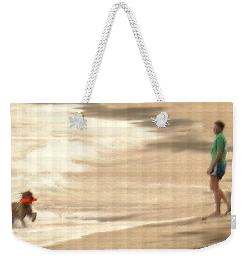 Dog Weekender Tote Bag featuring the photograph Playing On A Beach by Ian MacDonald