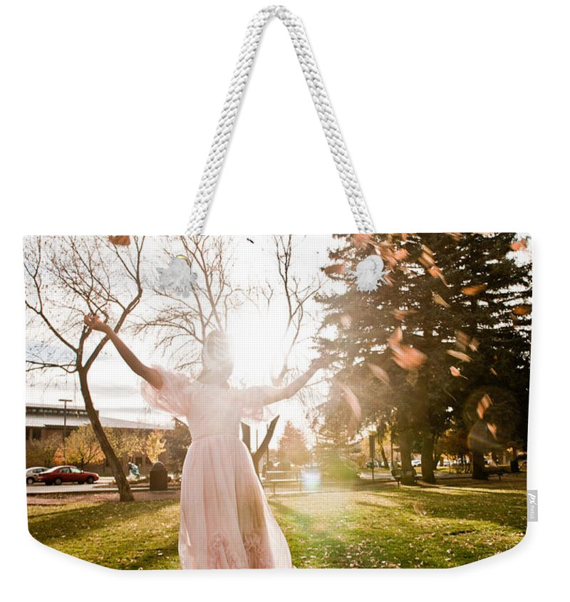 Pink Dress Weekender Tote Bag featuring the photograph Playing With Leaves by Scott Sawyer