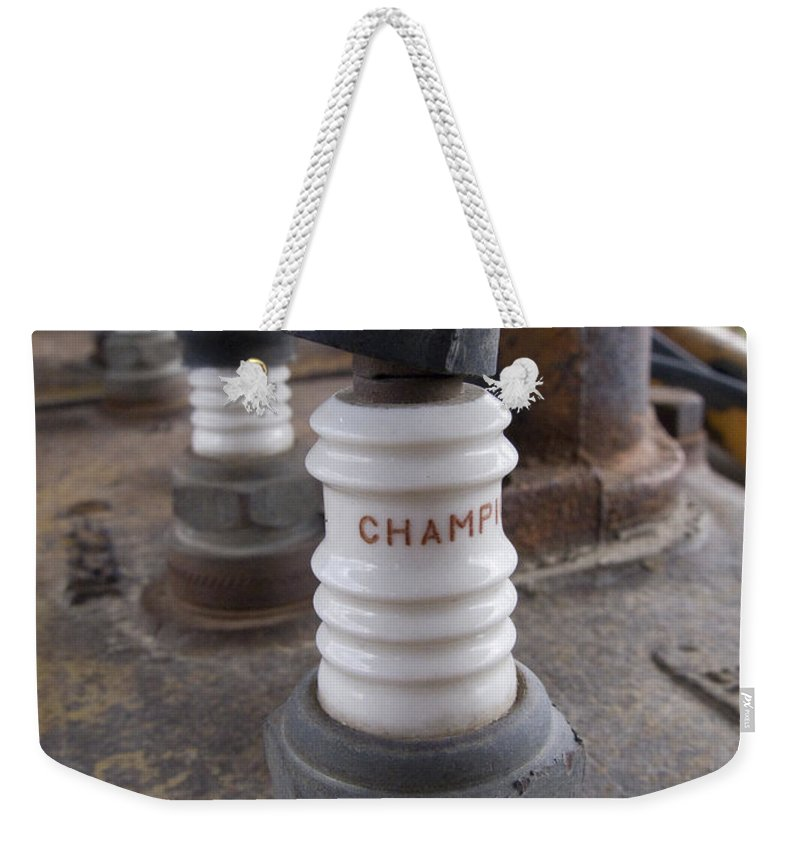 Spark Plugs Weekender Tote Bag featuring the photograph Plugs by Jeffery Ball