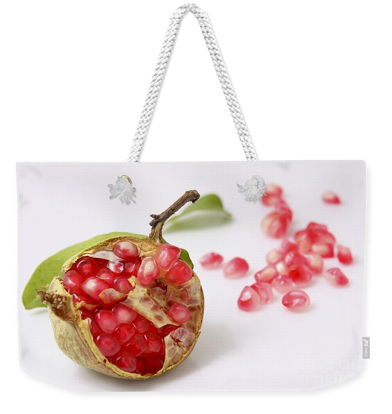 Pomegranate Weekender Tote Bag featuring the photograph Pomegranate And Seeds by Yedidya yos mizrachi