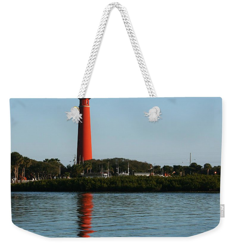 Lighthouse Tall Red Water Reflection Fl Sky Blue Wave Ripple Inlet Travel Tourist Vacation Weekender Tote Bag featuring the photograph Ponce Inlet Lighthouse by Andrei Shliakhau