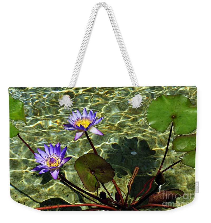 Clay Weekender Tote Bag featuring the photograph Pond Florals by Clayton Bruster