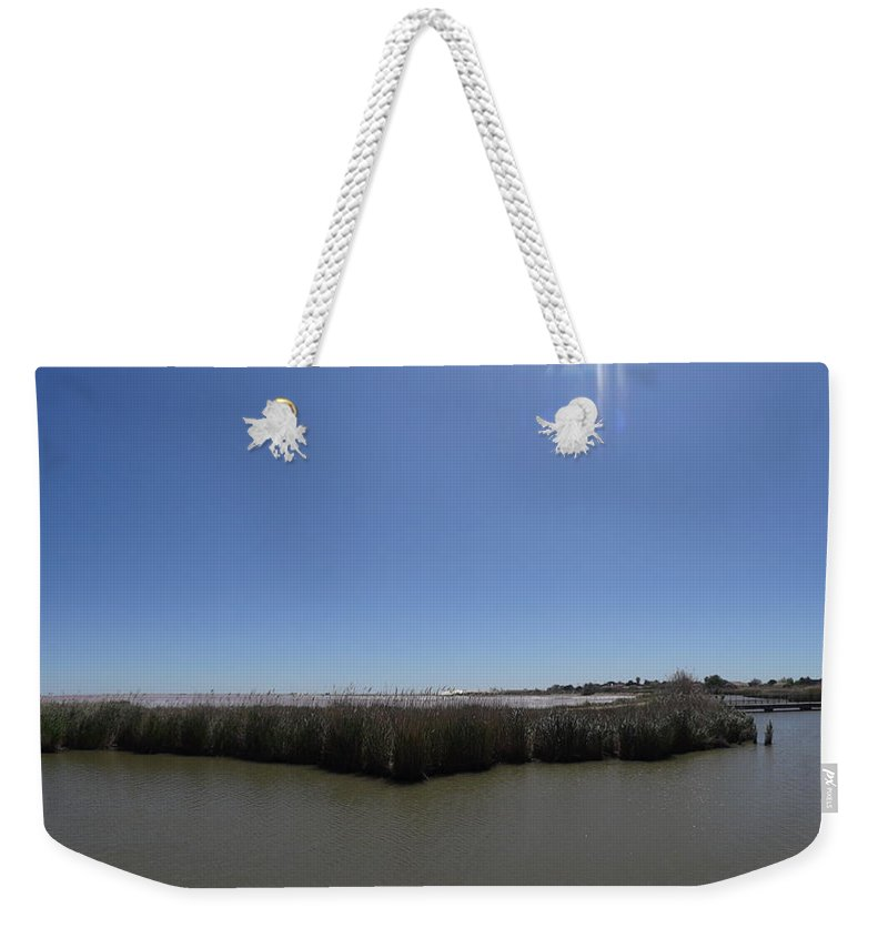 Weekender Tote Bag featuring the photograph Pong Of Salt Water In Aigues Morte by Andres Chauffour