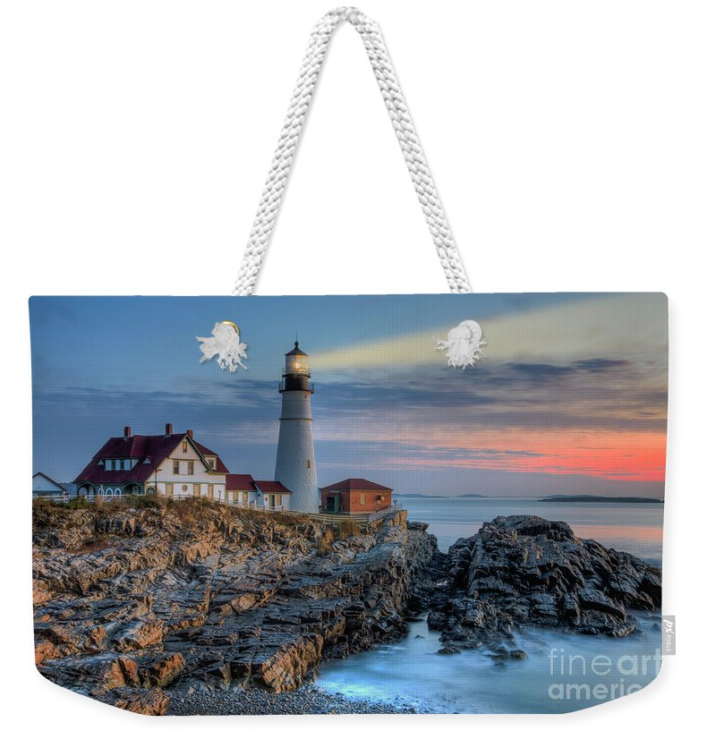 Clarence Holmes Weekender Tote Bag featuring the photograph Portland Head Light At Sunrise I by Clarence Holmes