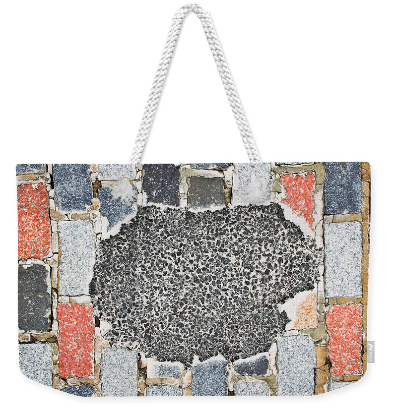 Abstract Weekender Tote Bag featuring the photograph Pothole Repair by Tom Gowanlock