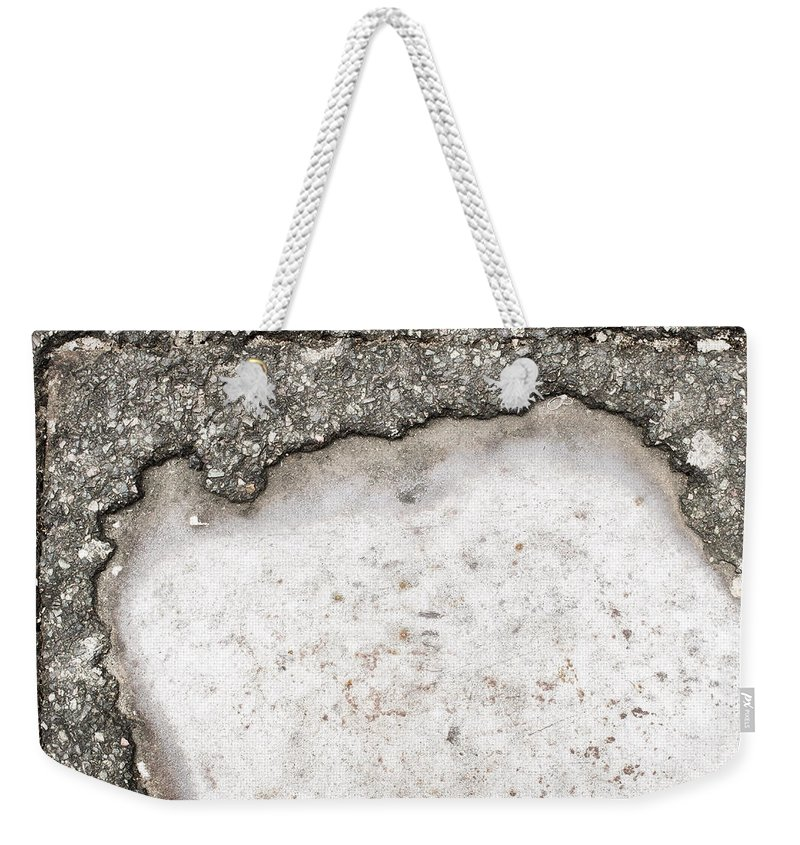 Abandoned Weekender Tote Bag featuring the photograph Pothole by Tom Gowanlock