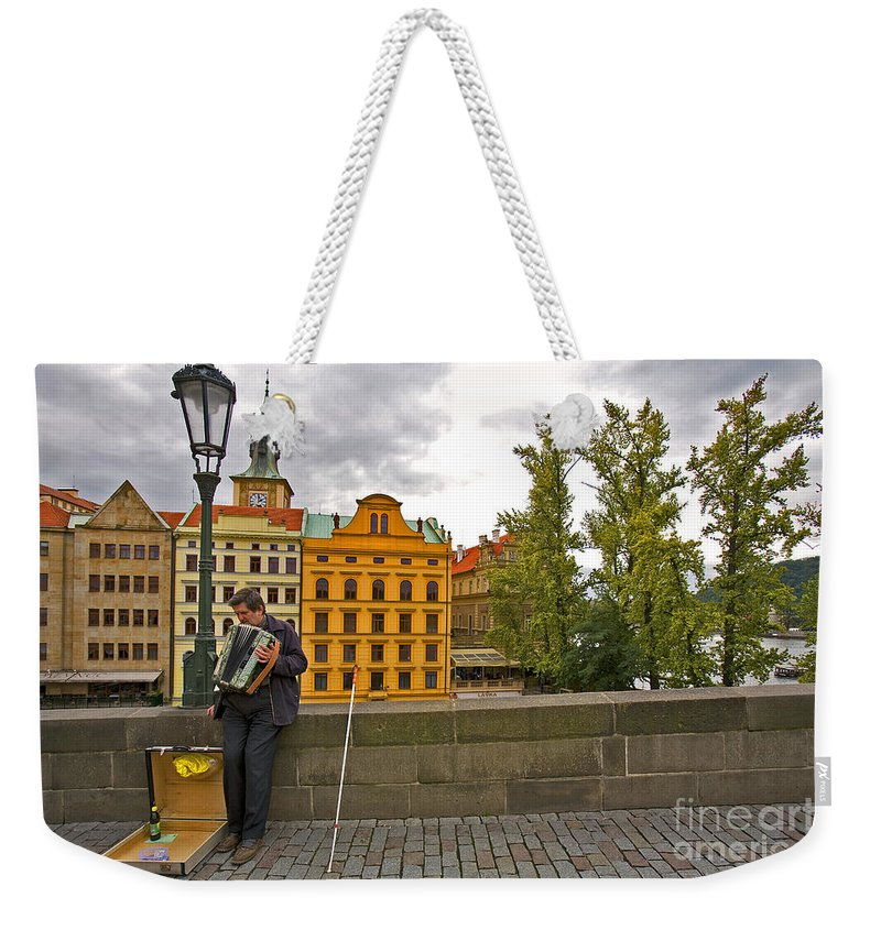 Accordian Player Weekender Tote Bag featuring the photograph Prague Accordian Player On Charles Bridge by Madeline Ellis