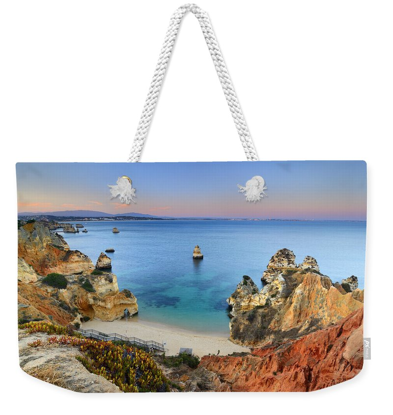Sunset Weekender Tote Bag featuring the photograph Praia Do Camilo At Sunset by Guido Montanes Castillo