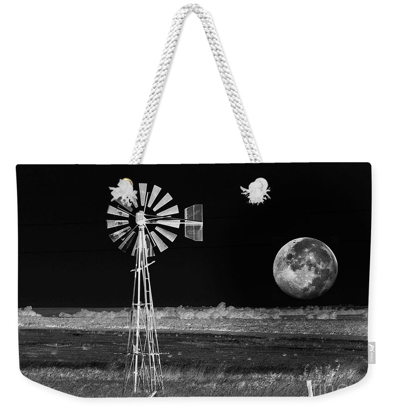 Kansas Weekender Tote Bag featuring the photograph Prairie Moon Rising by Concolleen's Visions Smith