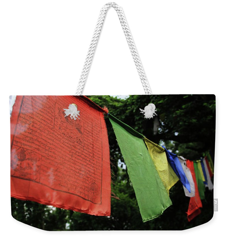 Weekender Tote Bag featuring the photograph Prayer Flags by Michael Swiderski