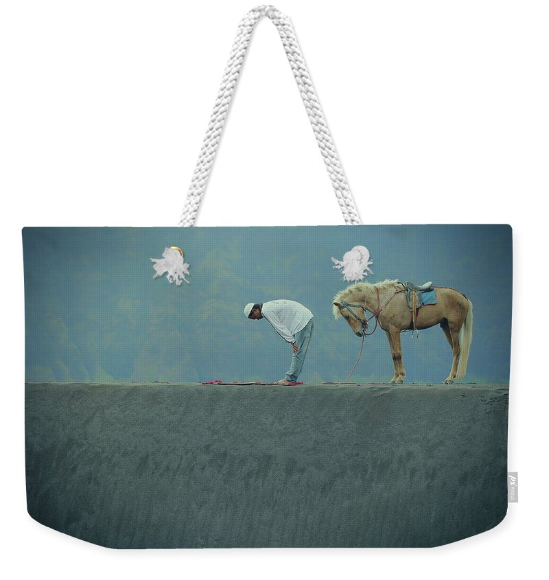 Prayers Weekender Tote Bag featuring the photograph Prayers by Asep Bowie
