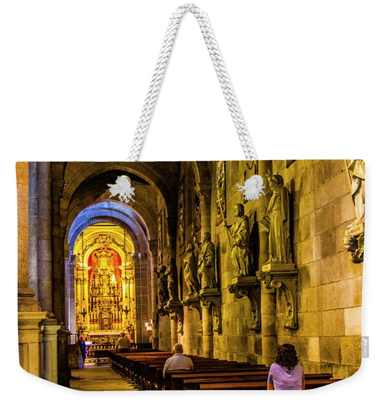 Braga Weekender Tote Bag featuring the photograph Prayers In The Cathedral by Roberta Bragan