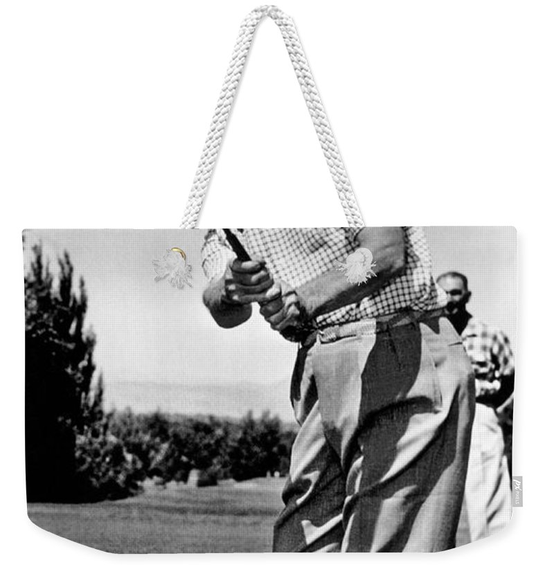 1 Person Weekender Tote Bag featuring the photograph President Eisenhower Golfing by Underwood Archives