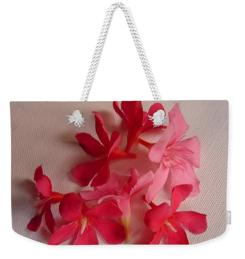 Foliage Weekender Tote Bag featuring the photograph Pretty Flowers by Usha Shantharam