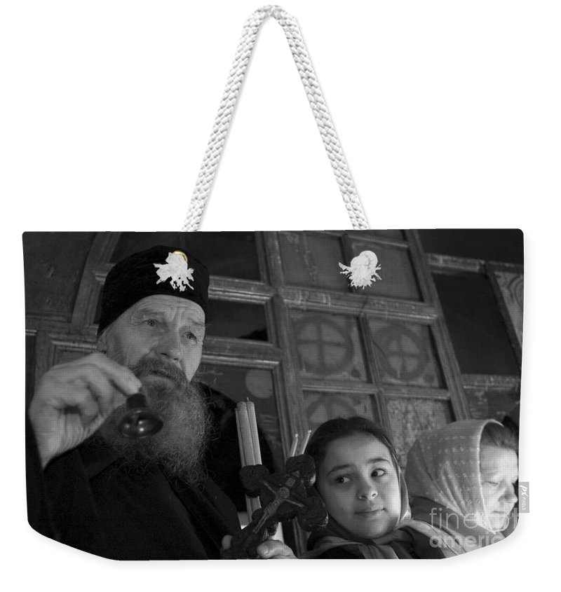 Christian Weekender Tote Bag featuring the photograph Priest And A Young Girl by Nahum Budin