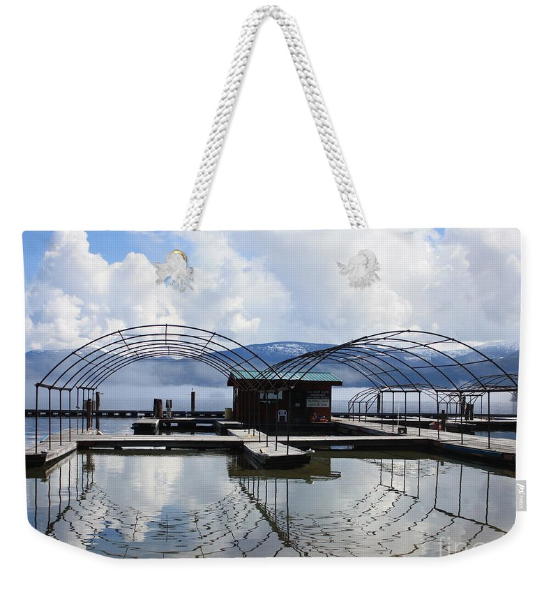 Priest Lake Weekender Tote Bag featuring the photograph Priest Lake Boat Dock Reflection by Carol Groenen
