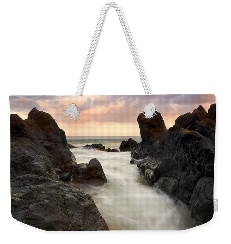 Sunrise Weekender Tote Bag featuring the photograph Primordial Tides by Mike Dawson