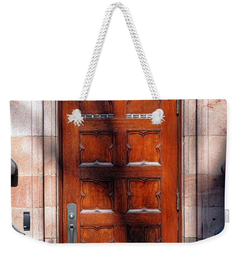 Princeton Weekender Tote Bag featuring the photograph Princeton University Wood Door by Olivier Le Queinec