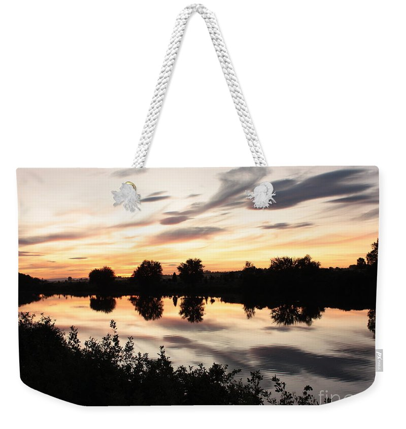 Prosser Weekender Tote Bag featuring the photograph Prosser Sunset With Riverbank Silhouette by Carol Groenen