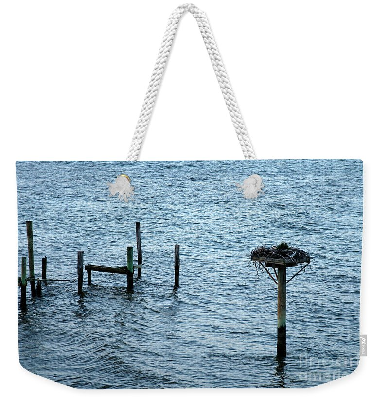 Clay Weekender Tote Bag featuring the photograph Protected Osprey Nest by Clayton Bruster