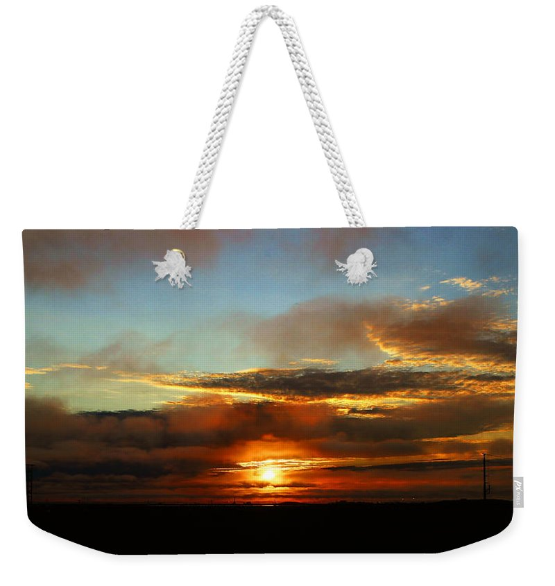 Sunset Weekender Tote Bag featuring the photograph Prudhoe Bay Sunset by Anthony Jones