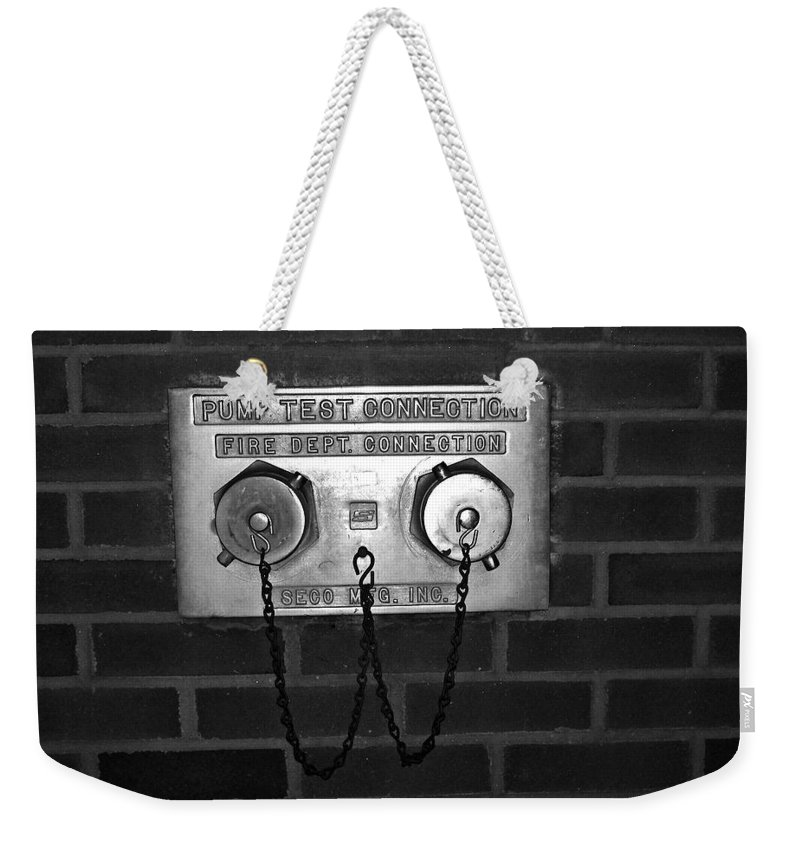 Color Photograph Weekender Tote Bag featuring the photograph Pump Test by Thomas Valentine