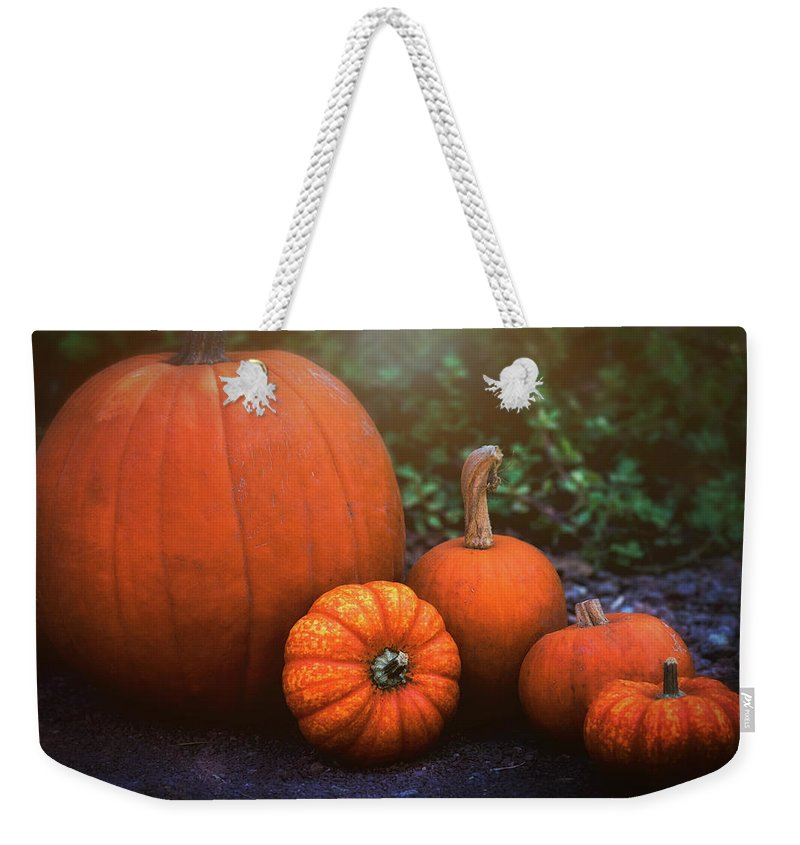 Pumpkins Weekender Tote Bag featuring the photograph Pumpkins by Saija Lehtonen