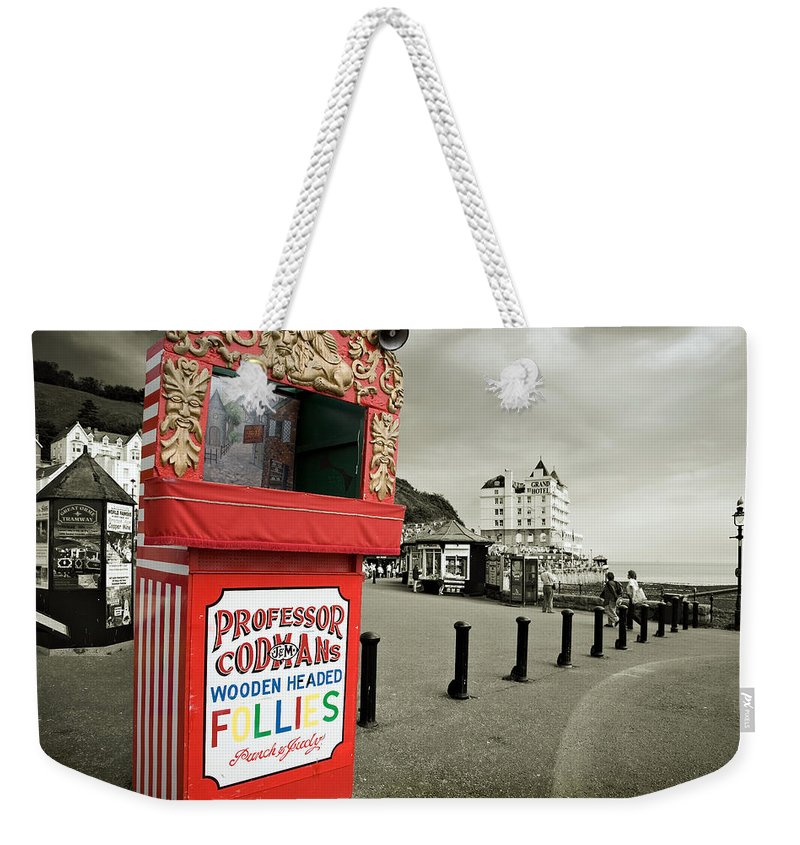 Punch And Judy Weekender Tote Bag featuring the photograph Punch And Judy Theatre On Llandudno Promenade by Mal Bray